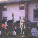 One of the skeletons standing the in yard