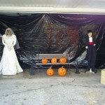 The bride and groom with the pumpkins