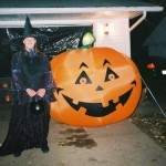 Me in my witch's costume next to the giant pumpkin